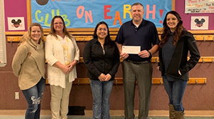 Members of our Lewiston, Idaho, team deliver a $5,000 contribution check to their local Boys & Girls Club.