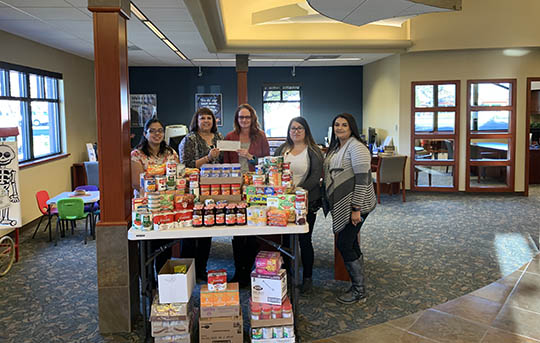 Members of our Twin Falls Branch showing what they collected for our annual food drive.
