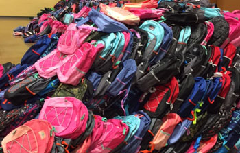 Pile of new kids backpacks