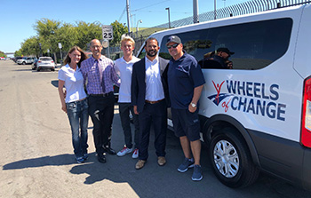 Members of our San Diego team stand with Wheels of Change and Alpha Project leaders in the effort to help the community's homeless population.