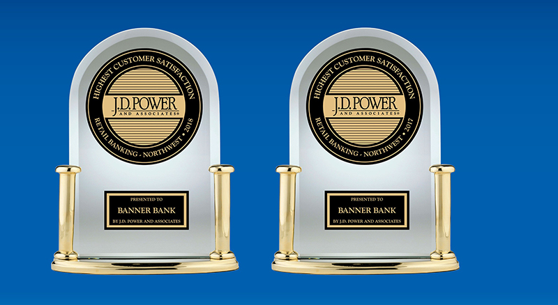 Banner Bank's two JD Power trophies for highest in client satisfaction in 2017 and 2018