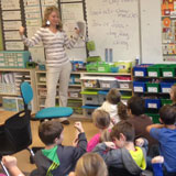 Banner Bank employee teaches elementary students about financial literacy.