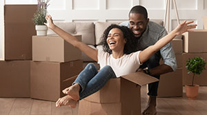 New homeowners celebrate with moving boxes