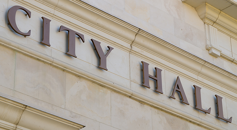 City hall sign on exterior of marble building in a city served by Banner Bank