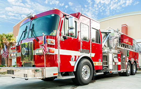 Banner Bank financed city fire truck sitting in front of a fire house