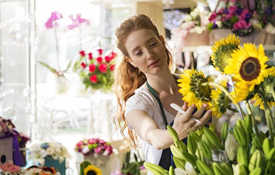 Flower shop owner with inventory