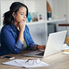 Woman checks her eStatements on a laptop using Banner Bank's online banking