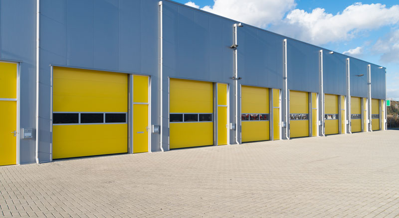 Warehouse garage bays with yellow doors financed with an income property permanent loan from Banner Bank