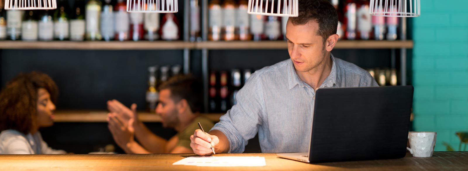 Bookkeeper does paperwork at restaurant