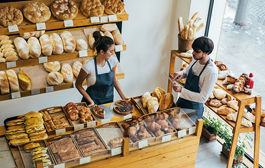 Two business partners manage a bakery