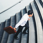 Man with briefcase walking up stairs