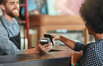 Woman making purchase with mobile device