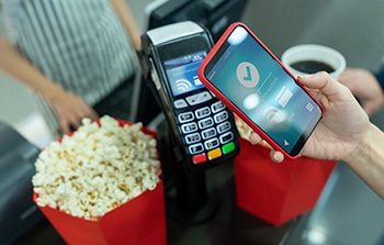 Digital wallet in use to pay for popcorn