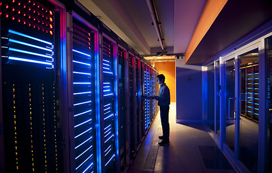 Person on computer in data center
