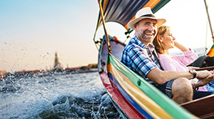 Couple in a colorful small boat on the water