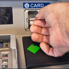 Man inserts card into an ADA accessible ATM at Banner Bank