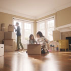 Family unpacks boxes in their new home