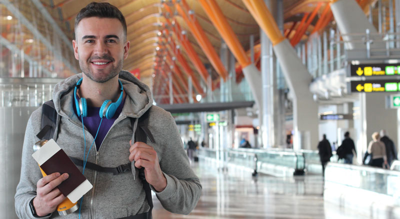 Man walk through airport with passport in hand