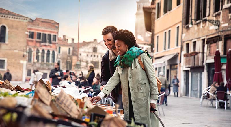 Couple shopping in European market