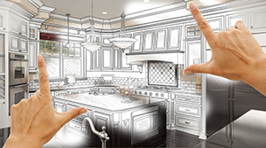 Two hands held out with index finger and thumbs extended at 90 degree angles framing an artist concept of a kitchen remodel