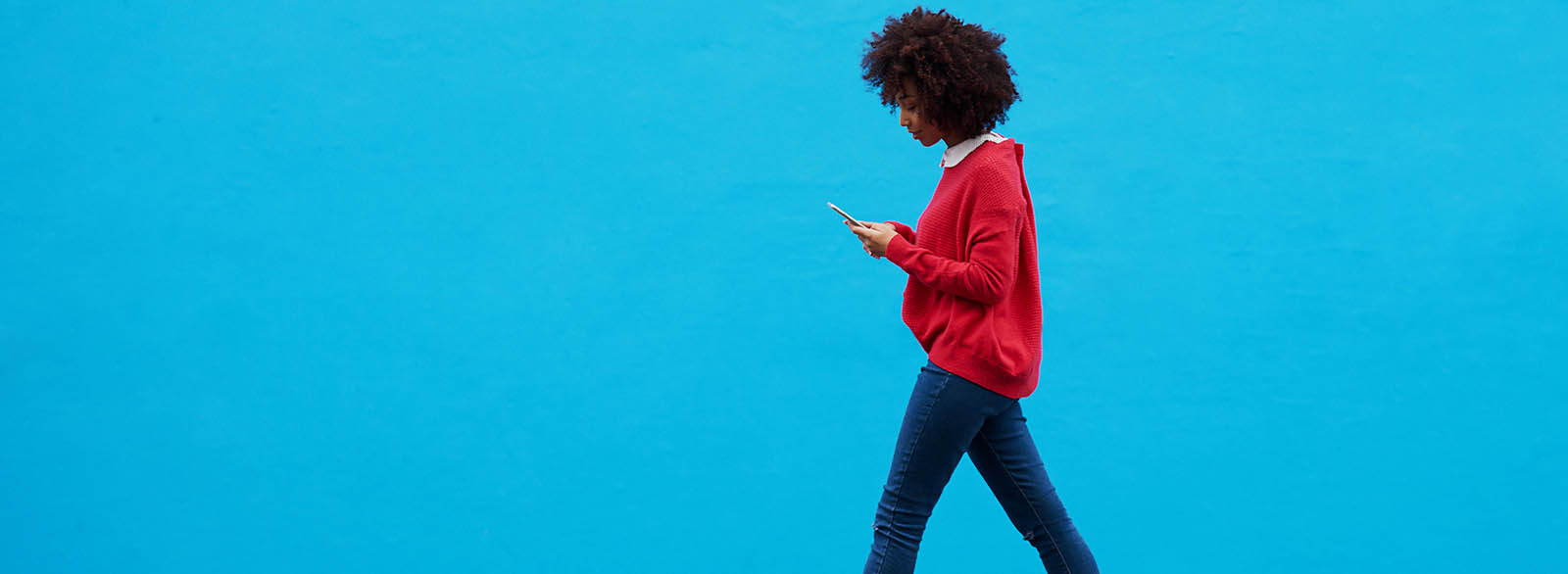 Person using mobile banking while walking