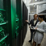 Man and woman review security protocols of a server room
