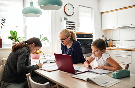Family working at studying at kitchen table