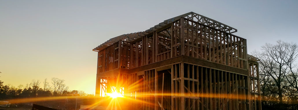 New home construction at sunrise