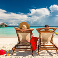 Couple lounges on sunny beach