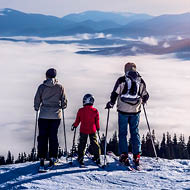 Family of skiers on top of mountain