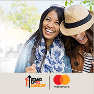 Friends laughing. Stand up to cancer and Mastercard logos.