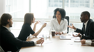 Team members discussing a company policy in a meeting
