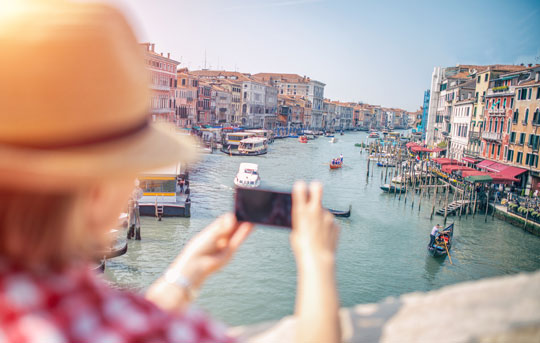 Traveler takes picture of Venice with smartphone