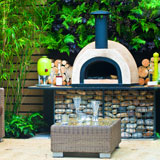 Backyard patio with pizza oven