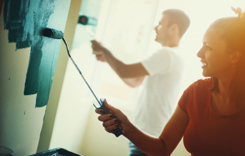 Couple painting and remodeling their home