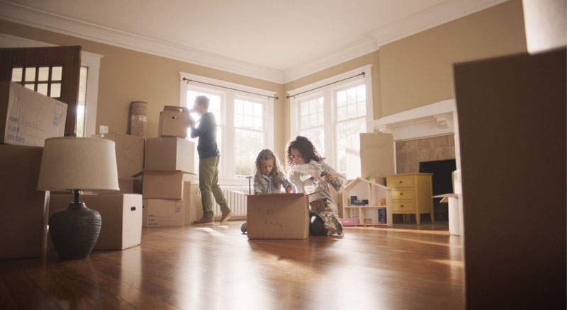 Family unpacks boxes in their new home thanks to a mortgage loan from Banner Bank