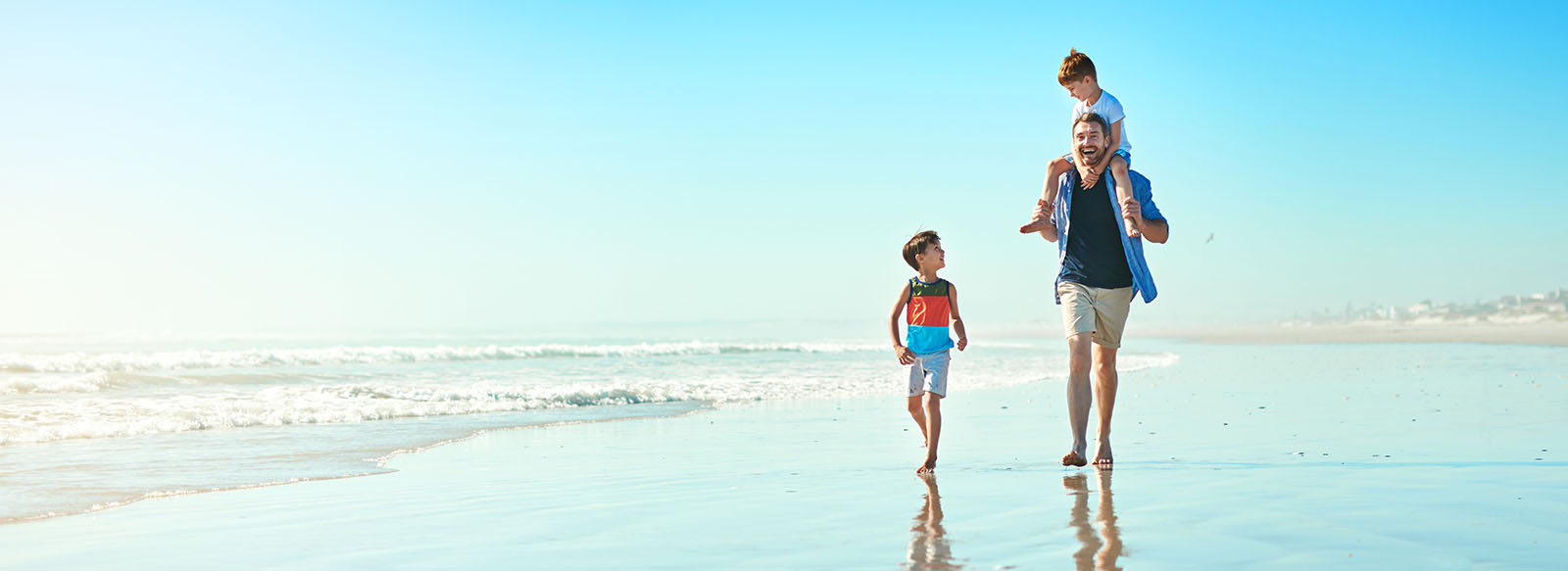 Photo of family walking on beach